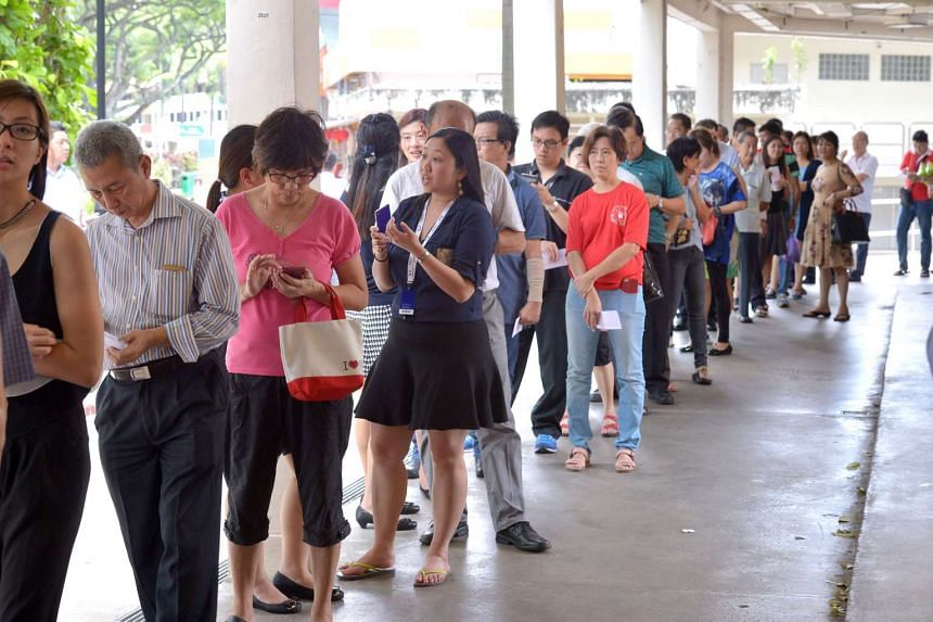 People queueing to buy Toto for the $13.9 million Hongbao draw at  Seah Koon Huat, Bukit Merah View on Feb 17, 2016.