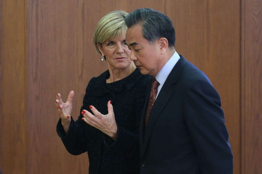 Chinese Foreign Minister Wang Yi (right) and his Australian counterpart Julie Bishop speaking at the Ministry of Foreign Affairs in Beijing.