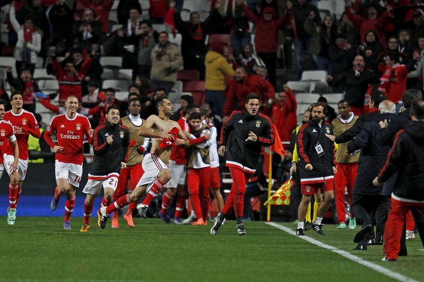 Benfica's Jonas celebrates with team mates after scoring a goal against Zenit St Petersburg.