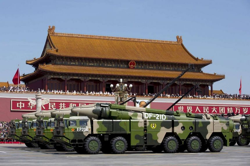 Chinese military vehicles going past Tiananmen Gate during a military parade to commemorate the 70th anniversary of the end of World War II, on Sept 3, 2015.
