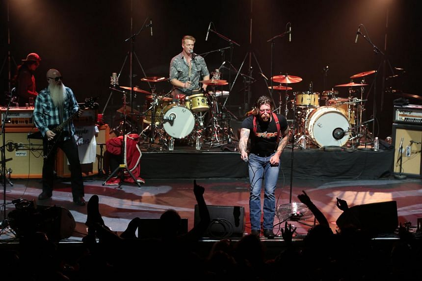US rock group Eagles of Death Metal on stage at the Olympia concert hall in Paris on Feb 16.