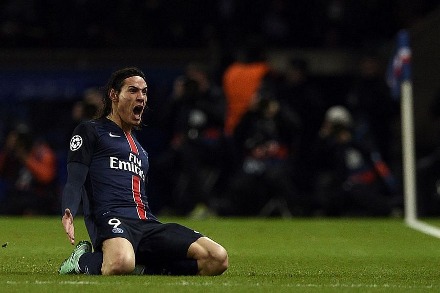 Edinson Cavani celebrates scoring during the Champions League round of 16 first leg football match between Paris Saint-Germain (PSG) and Chelsea.