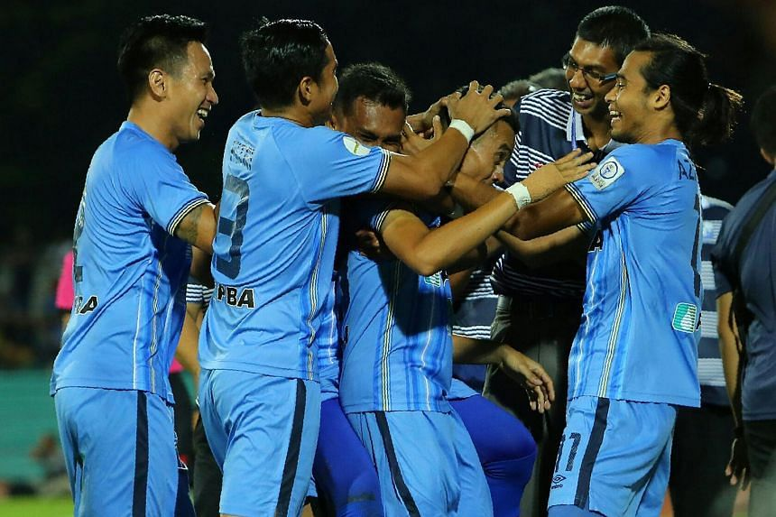 Faiz mobbed by teammates after scoring his incredible freekick goal.