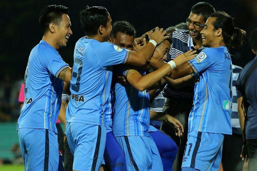 Faiz mobbed by teammates after scoring his incredible freekick goal.