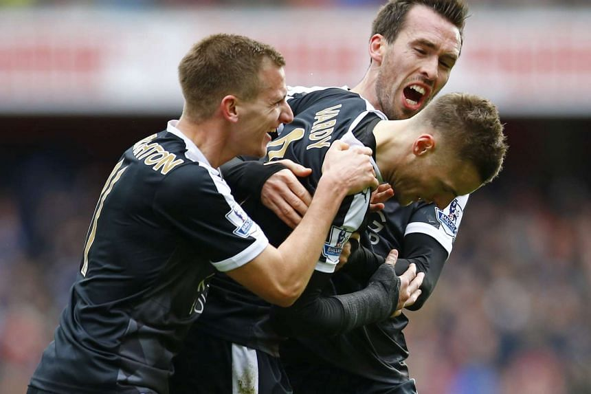 Jamie Vardy (centre) celebrating with team mates after scoring for Leicester against Arsenal on Feb 14.
