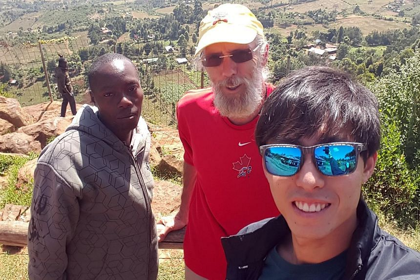 Soh Rui Yong spends his Sunday rest day with Manasess Kemei (left) of Kenya and 64-year old Canadian John (centre).