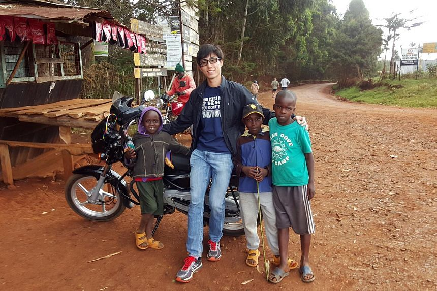 Soh Rui Yong with some Kenyan children in the village where he is currently training at high altitude.