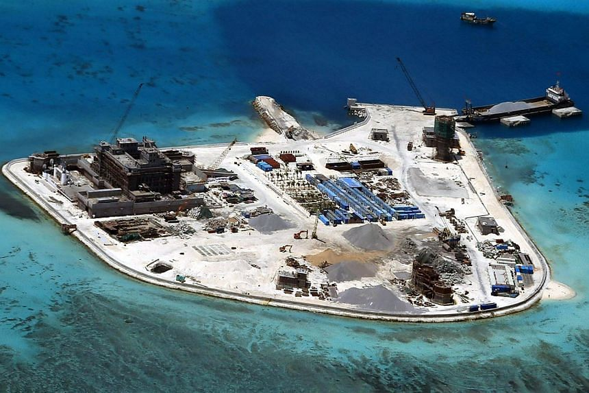 A file handout picture dated Feb 18, 2015, shows an aerial view of construction at Mabini (Johnson) Reef by China, in the disputed Spratley Islands, in the south China Sea.