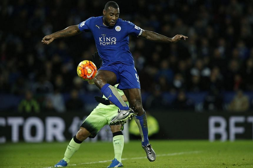 Wes Morgan tries to control the ball during the English Premier League football match between Leicester City and Manchester City.