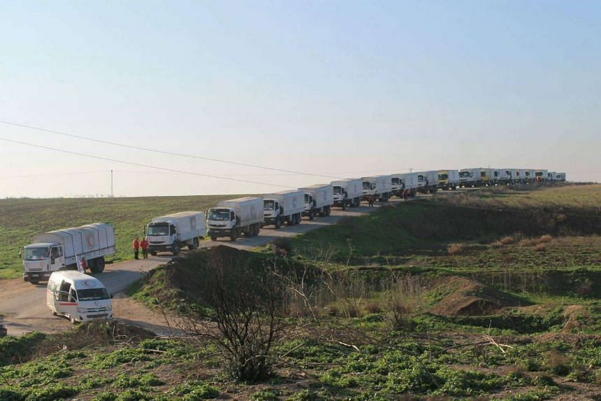 Aid trucks line a road before their departure for Damascus on Wednesday (Feb 17).