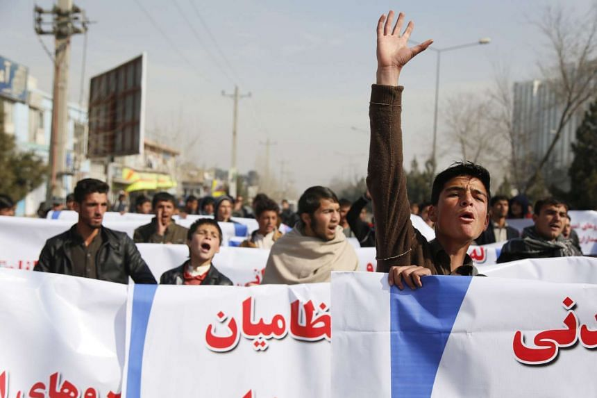 Afghans shout slogans during an anti-Taleban protest in Kabul, Afghanistan on Wednesday (Feb 17).