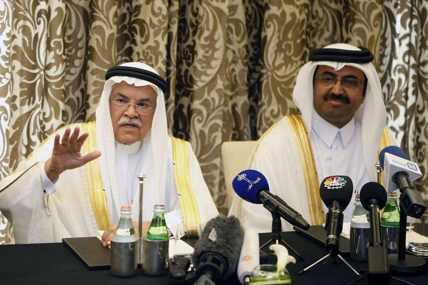Energy and Industry Mohammed Saleh al-Sada during a press conference in Doha on Feb 16.
