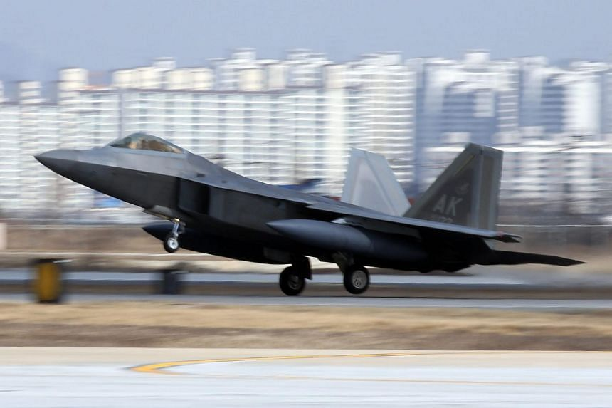 One of the four US Air Force F-22 Raptors, deployed by the US military, lands at Osan Air Base, south of Seoul.