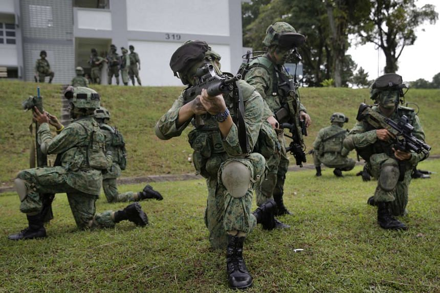 Soldiers preparing for a drill at Amoy Quee Camp on Nov 26, 2015.