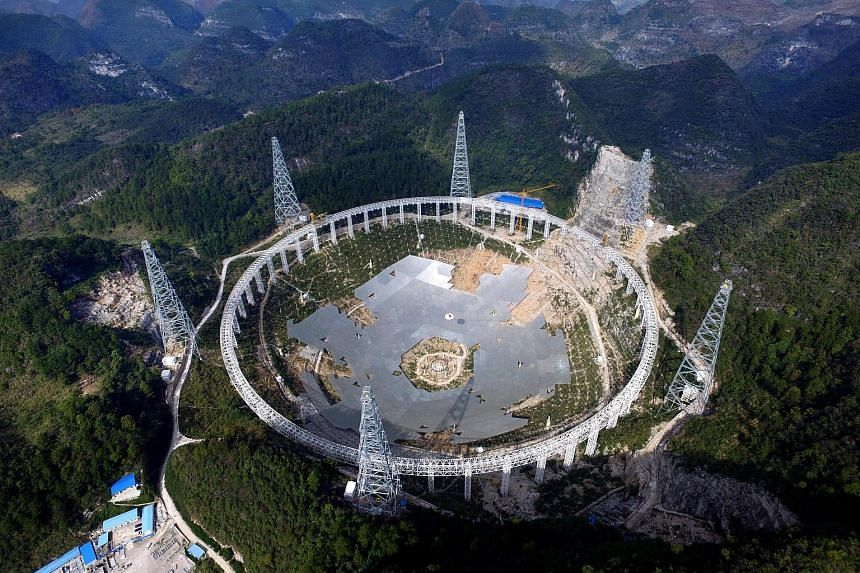 The 500m Aperture Spherical Radio Telescope is being built to the tune of 1.2 billion yuan (S$260 million).