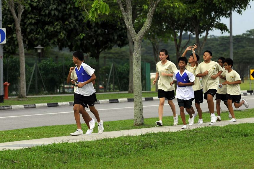 Members of the Christ Church Secondary School Outdoor Activity Club finishing a run.