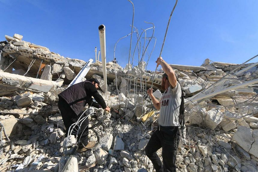 People look for survivors in the ruins of a destroyed MSF supported hospital hit by missiles in Marat Numan, Syria.