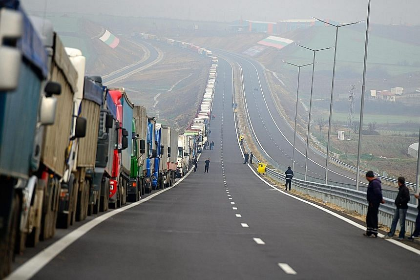 Angry Bulgarian truck drivers blocked off the country's main border checkpoint with Greece yesterday to protest against weeks of blockades by Greek farmers that intermittently disrupted traffic. The farmers have demonstrated for over a month against