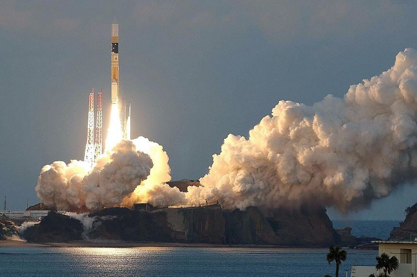 An H-IIA rocket, carrying the ASTRO-H satellite, lifting off at Tanegashima Space Centre yesterday.