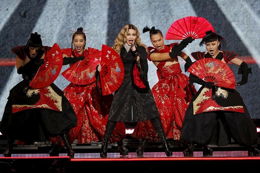 Mr James Lee (above), chief executive of Kinglun International Holdings, is one of two investors bringing Madonna's Rebel Heart tour (top) to Singapore.