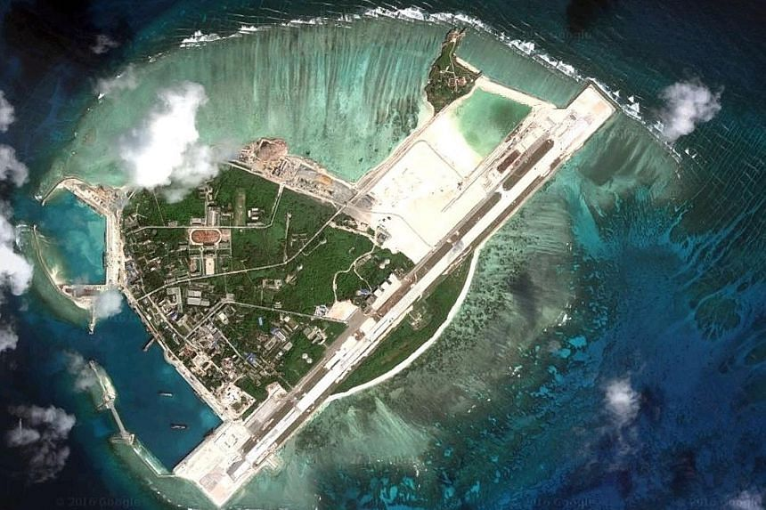 An earlier satellite image of the China-controlled Woody Island, which is part of the Paracel chain also claimed by Taiwan and Vietnam. The reported missile deployment drew swift condemnation, but China's Foreign Minister said Beijing was entitled to