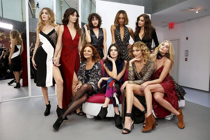 Fashion designer Diane von Furstenberg (seated, left) and models in a fashion show held at her Manhattan office on Sunday.