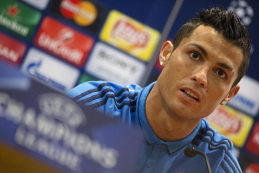 """At this press conference in Rome, Real star Cristiano Ronaldo said that the off-pitch camaraderie reportedly enjoyed by Barcelona trio Lionel Messi, Luis Suarez and Neymar was over-rated. The """"little meals, the little hugs, the little kisses"""" do not"""