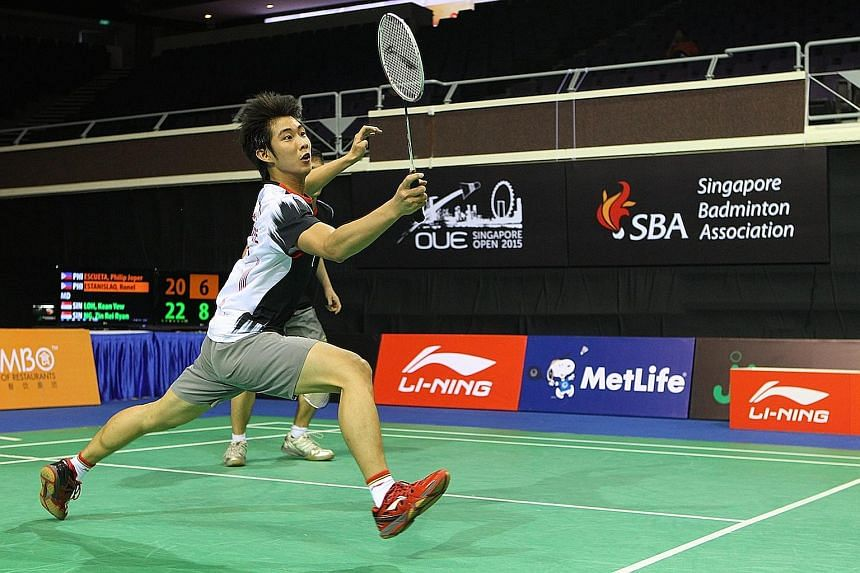 Loh Kean Yew upset Wang Zhengming and his older brother Kean Yean had a shock doubles win with partner Terry Hee.