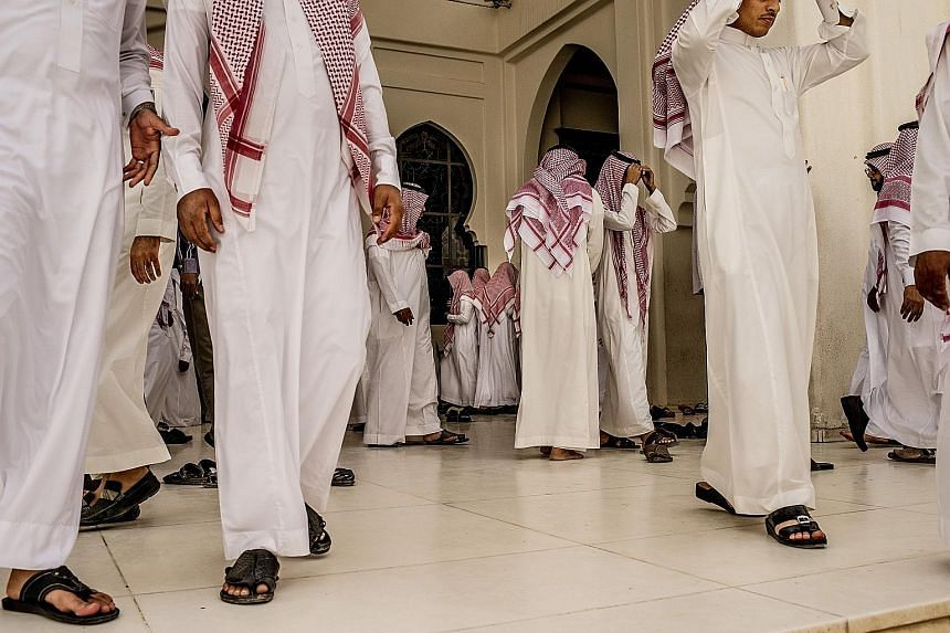 Worshippers leaving a mosque in Riyadh after prayers. For decades, the royal family has used the kingdom's immense oil wealth to lavish benefits on its people, but the plunge in oil prices is changing all that.