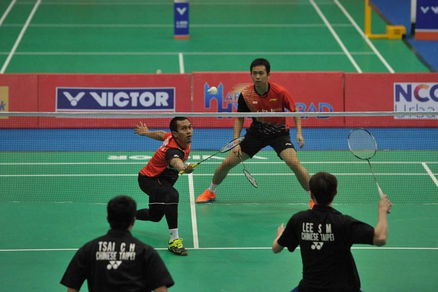 Mohammad Ahsan (left) and Hendra Setiawan play against Sheng Mu Lee and Chia Hsin Tsai during their men's doubles match at the Badminton Asia Team Championships.