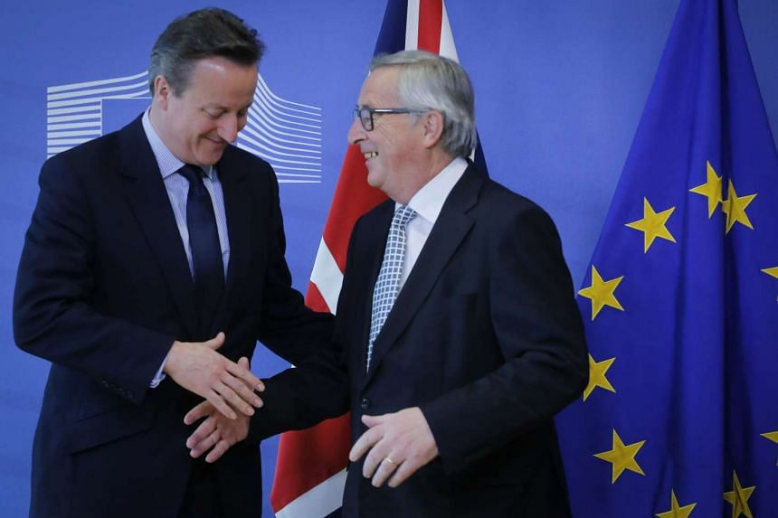 British Prime Minister David Cameron (left) is welcomed by European Commission President Jean-Claude Juncker on Feb 15, 2016.