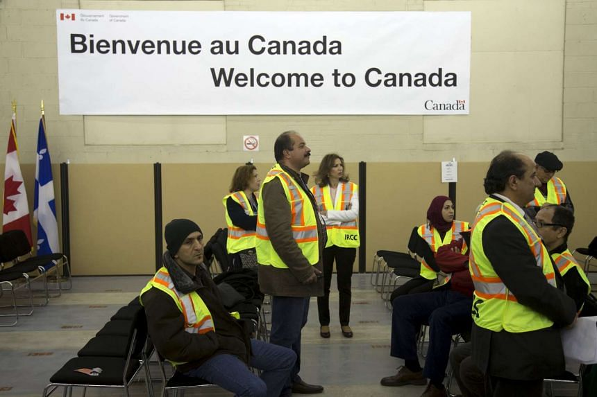 Translators await the arrival of Syrian refugees at the Welcome Centre in Montreal.