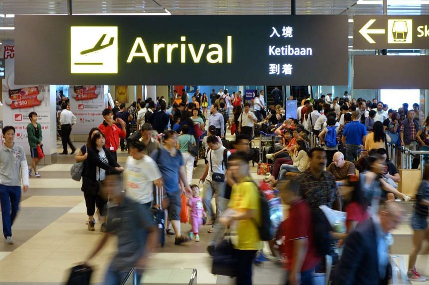 Travellers and tourists at the arrival hall of Changi Airport Terminal 1.