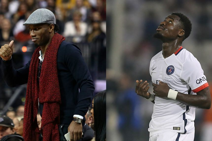 Former Ivory Coast captain Didier Drogba (left) claims compatriot Serge Aurier has been treated unfairly over his ban for abusing coach Laurent Blanc.