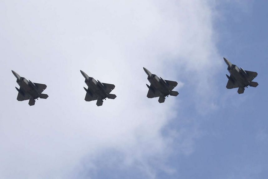 Four US Air Force F-22 Raptor stealth jets soar above Osan Air Base, south of Seoul.