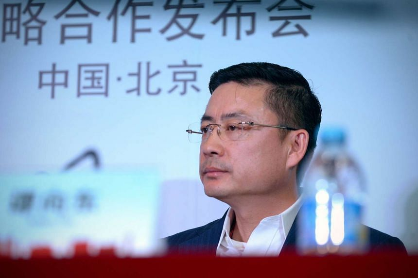 HNA Group vice president Tan Xiangdong at a press conference in Beijing on Jan 11, 2016.