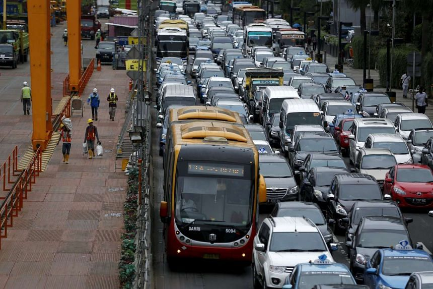 Rush hour traffic is seen next to a construction site for a light railway in Jakarta, Indonesia, on Feb 11, 2016.