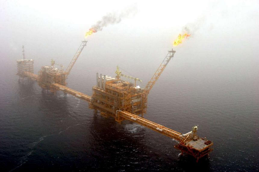 Gas flares from an oil production platform at the Soroush oil fields in the Persian Gulf.