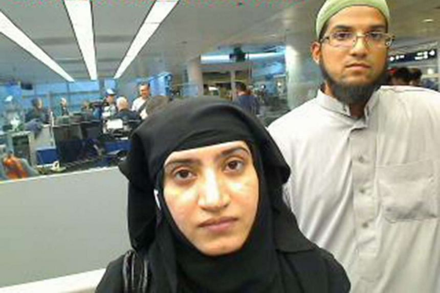 San Bernardino killers Tashfeen Malik (left)  and Syed Farook are pictured at an airport in this 2014 file photo.