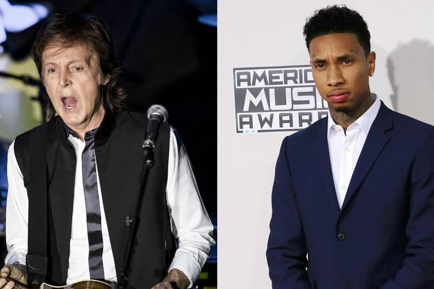 Rapper Tyga (right) has offered to escort former Beatle Paul McCartney after the latter was turned away from the hip-hop star's post-Grammy party.