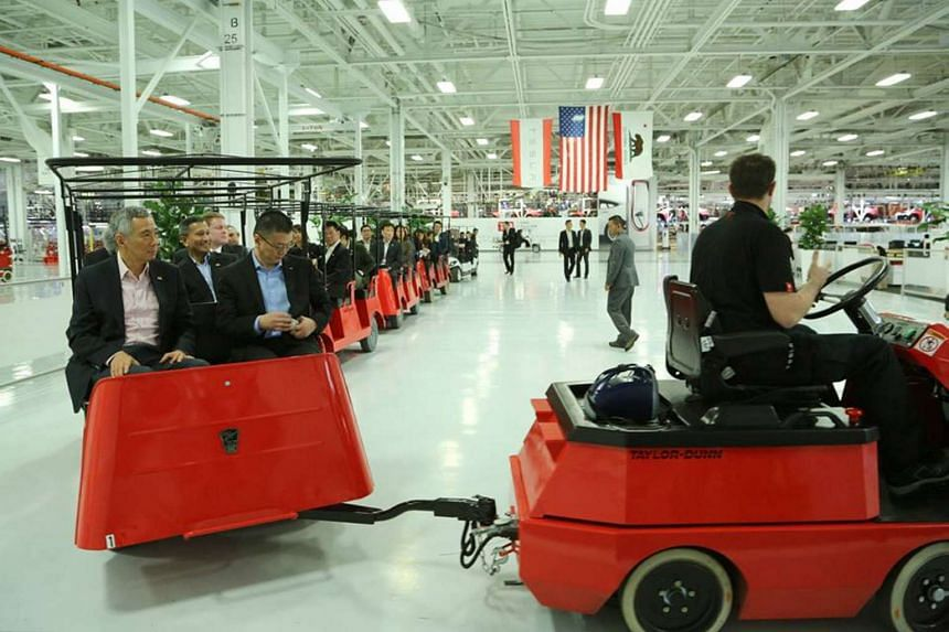 Prime Minister Lee Hsien Loong (left), visiting the Tesla Factory in the Silicon Valley in Fremont, California, on Feb 12, 2016.