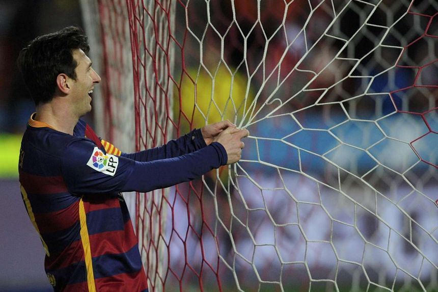 Barcelona's Lionel Messi reacts duringt the match on Wednesday (Feb 17).