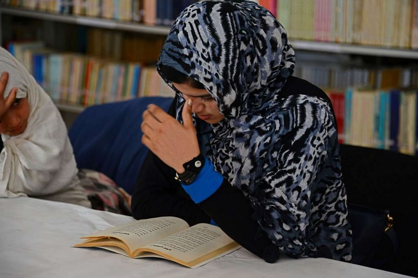 Afghan woman Nadia, 20, reading love poems at a poetry club in Kandahar on Jan 9, 2016.
