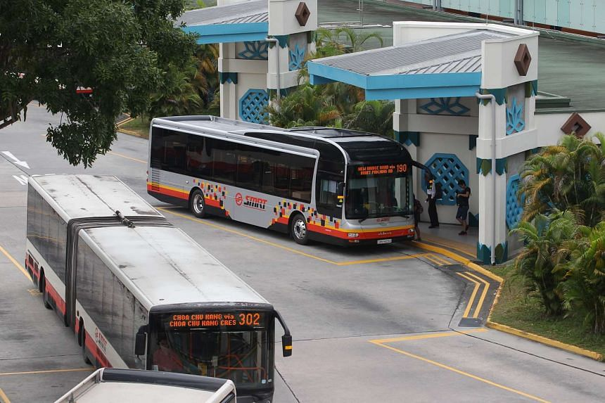 A SMRT bus with the new colours (right) and one with the old ones at Choa Chu Kang bus interchange on Jan 21, 2014.