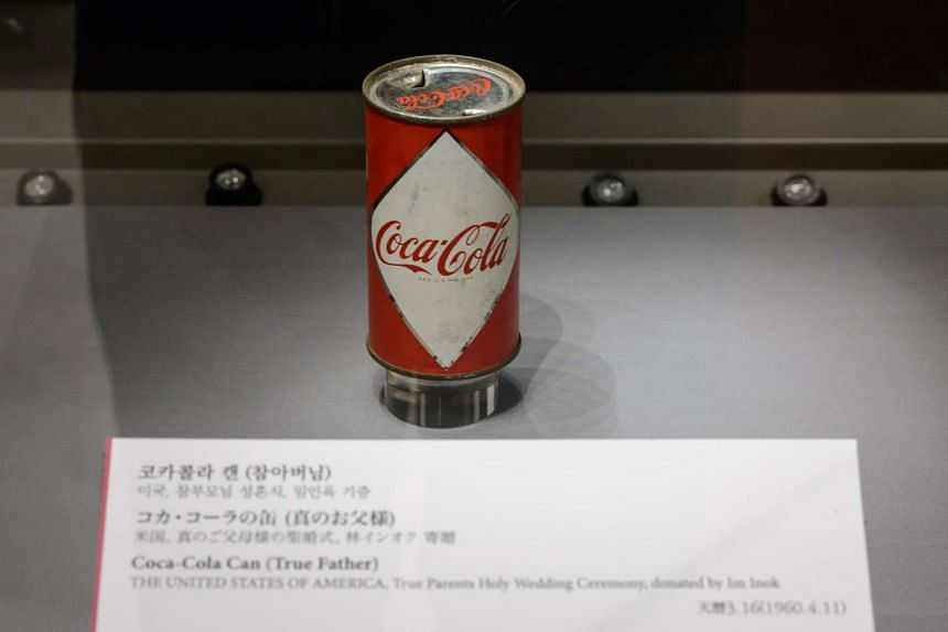 A Coca-Cola can partially consumed by the late reverend Sun Myung Moon at the Cheon Jung Gung Museum of the Unification Church, Seoul.
