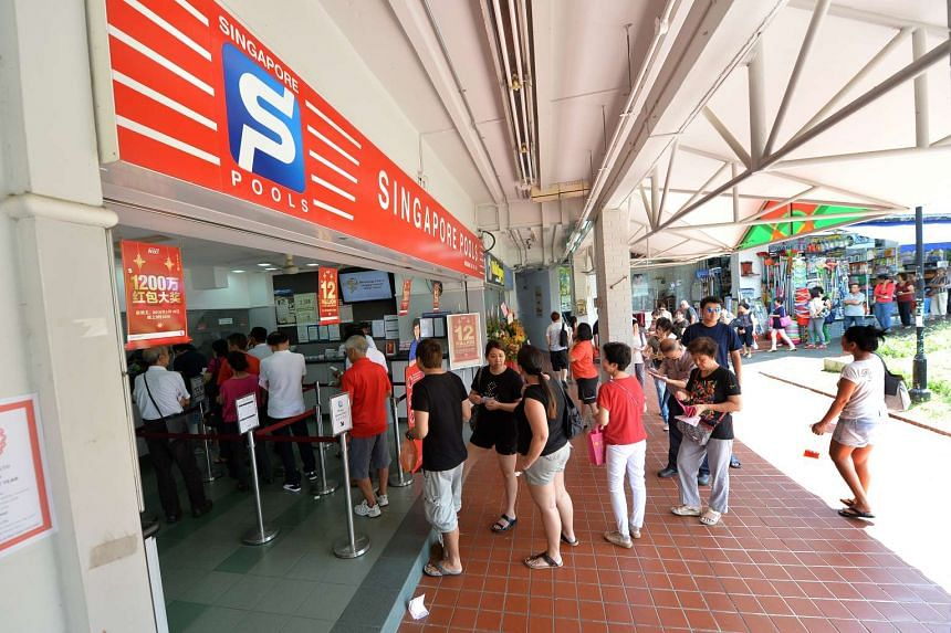 The start of the long queue on Feb 17 at Singapore Pools' Hougang N2 Branch at Block 211, Hougang Street 21, the outlet that had the sole winning entry of $9.5 million for the Toto draw on Feb 11.