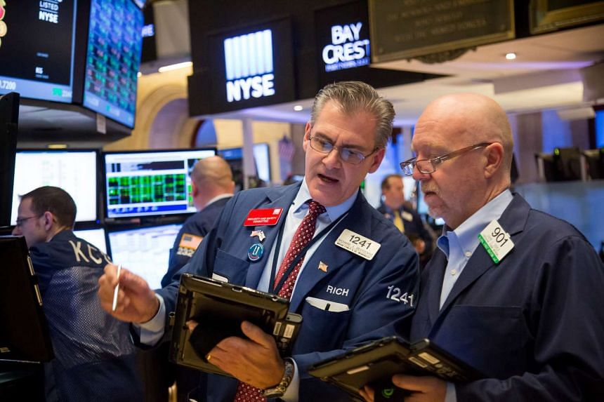 Traders work on the floor of the New York Stock Exchange in New York, on Feb 16, 2016.