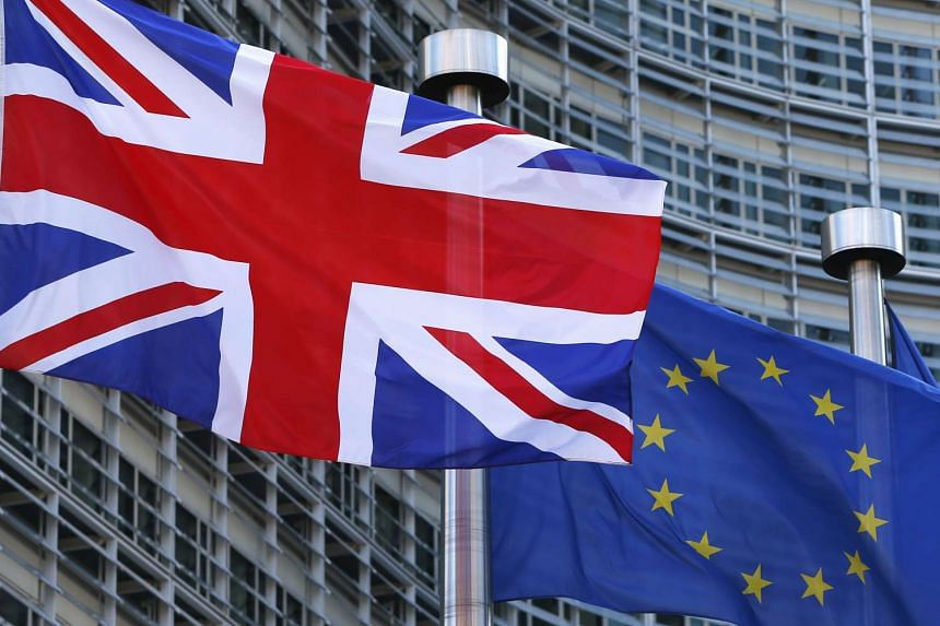 A Union Jack flag flutters next to European Union flags ahead of a visit from Britain's Prime Minister David Cameron at the EU Commission headquarters in Brussels.