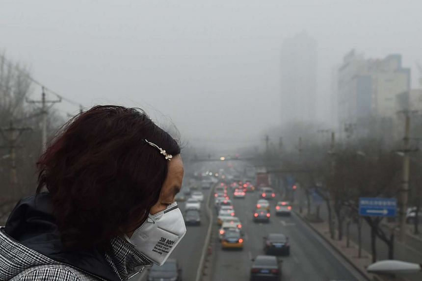 A woman wearing a face mask on a heavily polluted day in Beijing on Dec 26, 2015.