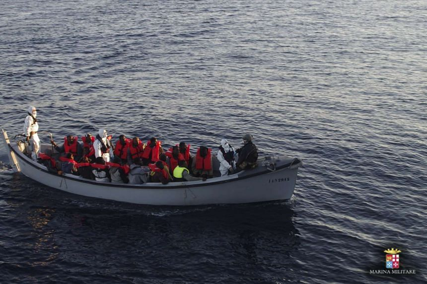 Migrants are rescued by the Italian Navy in the Mediterranean Sea.